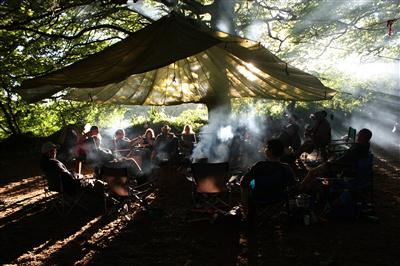 bushcraft group around fire