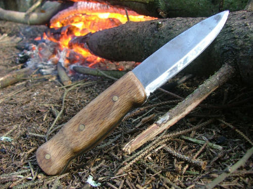 Bushcraft Knife Finished Fire wood bushcraft handle shown in woodlands
